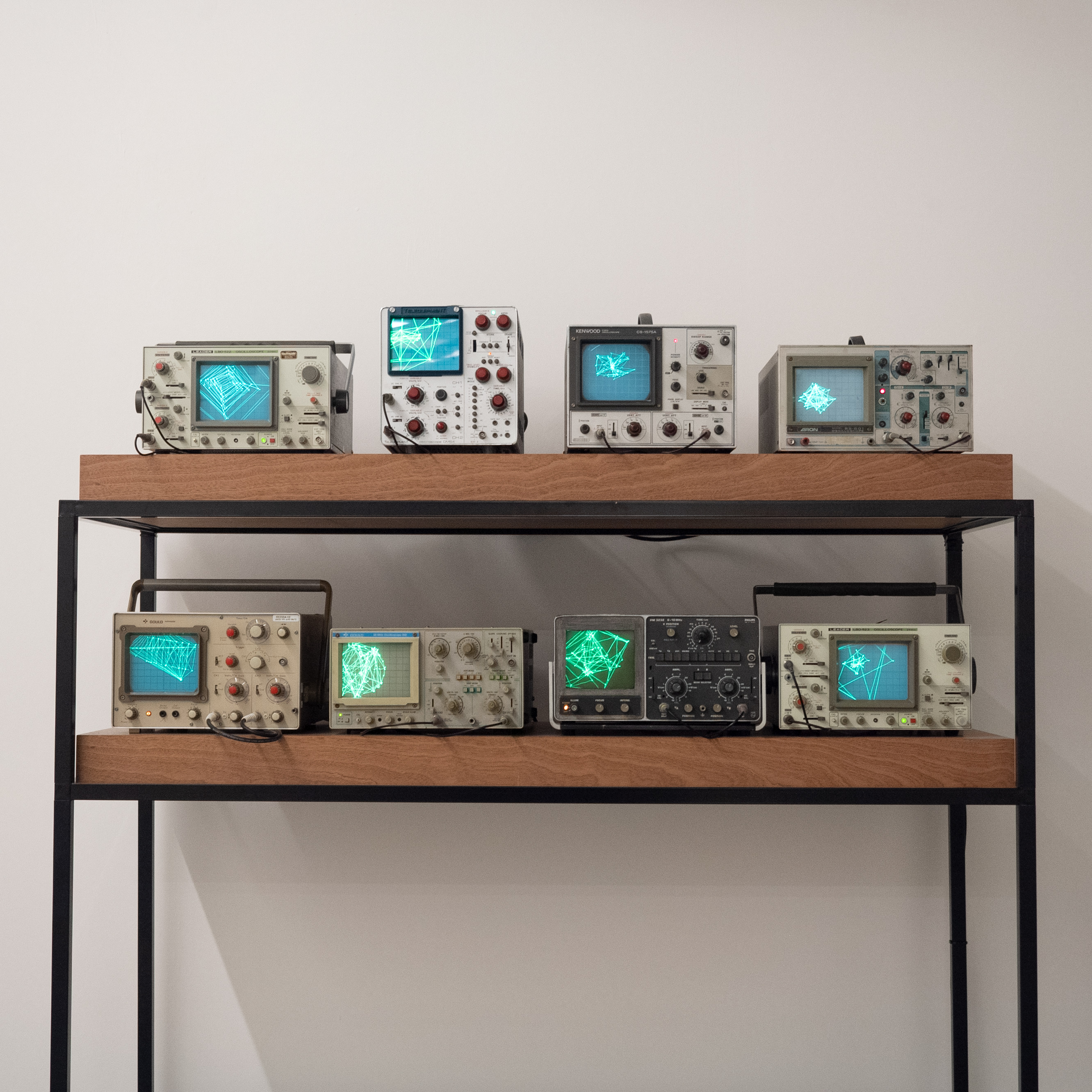 The Traces We Leave (2020) 176cm (h) x 145cm (w) x 78cm (d)  Eight assorted CRT oscilloscopes, aluminium and wood plinth, Sound interface, computer, cables,  Custom software, heart rate, voice and movement data.